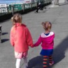 little girls walking holding hands